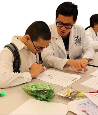 CSUF pre-health postbacc dental alum Evan Chang and student