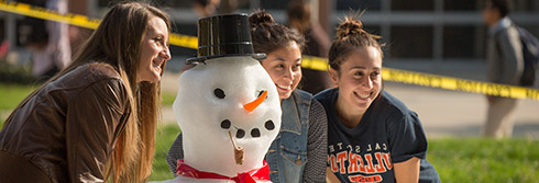 three female students with snowman